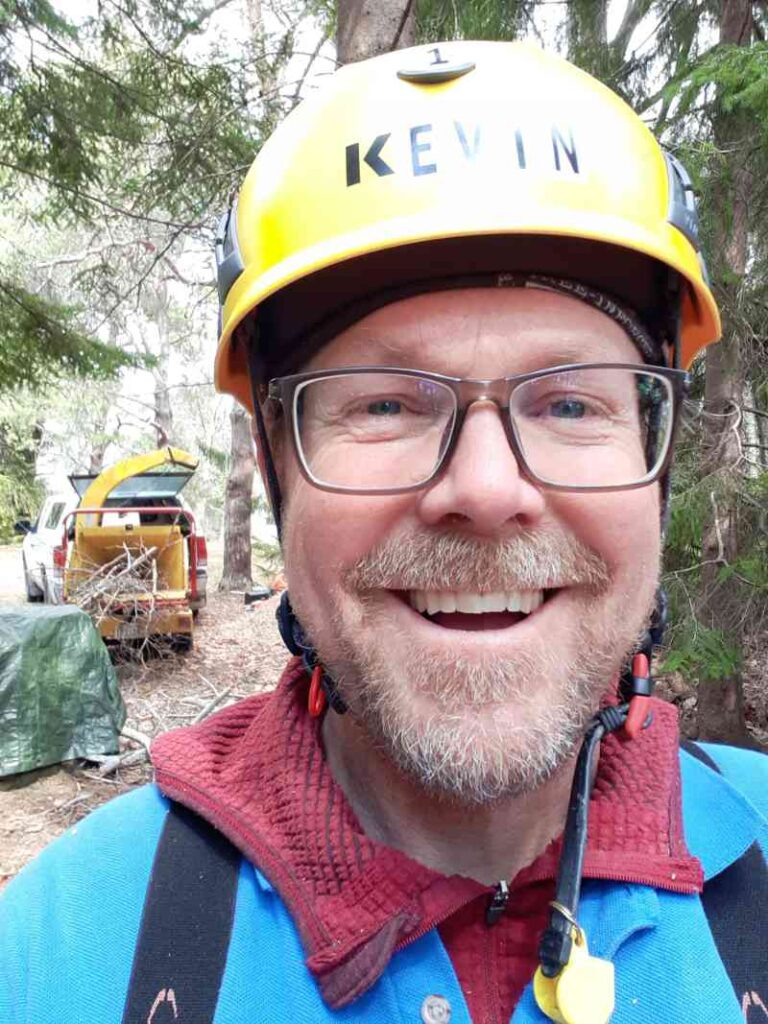 Head shot of Kevin Anderson in front of a Vermeer BC600XL brush chipper