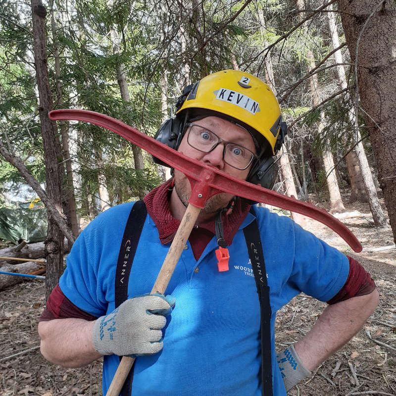 Certified arborist Kevin Stearns-Anderson, owner of Woodpecker Tree Care horses around pretending his rake is a moustache