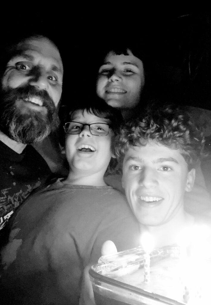 Luciano Onichino smiles with his three children.
